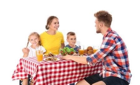 Photo pour Happy family having picnic at table on white background - image libre de droit