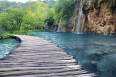 Wooden bridge over lake and beautiful view of waterfall