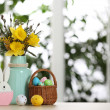 Festive composition with Easter eggs in wicker bas...