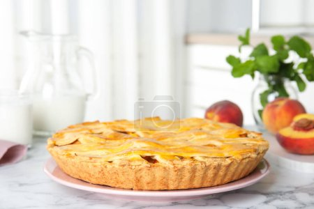 Photo for Delicious peach pie and fresh fruits on white marble table - Royalty Free Image