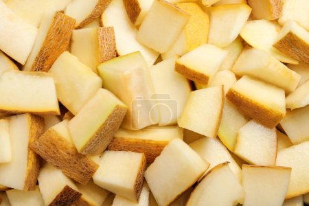 Photo for Pieces of delicious honey melon as background, top view - Royalty Free Image