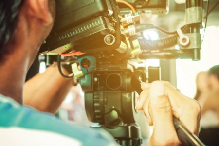 Photo for Behind the scene. cameraman shooting film scene with camera - Royalty Free Image
