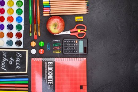 Photo for School supplies on black board background colorful september - Royalty Free Image