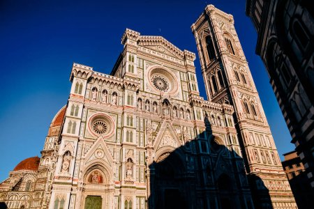Duomo Cathedral with Giotto Bell Tower Facade in Florence, Italy