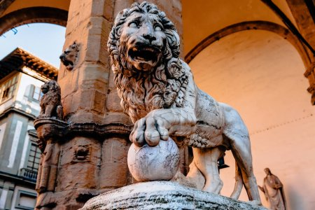 beautiful statue of lion at famous Loggia dei Lanzi in Florence, Italy