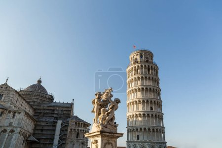 Photo for Cathedral, leaning tower and angels sculpture on Square of Miracles in Pisa, Italy - Royalty Free Image