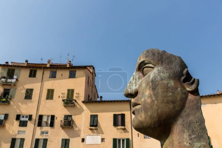 Photo for Sculpture of head in historical mediterranean city, Pisa, Italy - Royalty Free Image