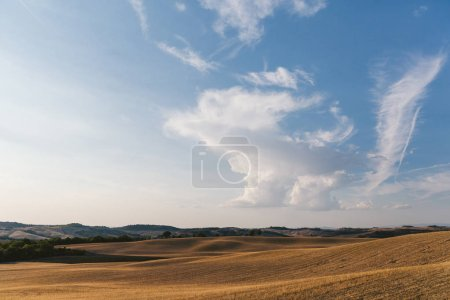 Photo for Scenic view of beautiful Tuscany fields with clouds on blue sky, Italy - Royalty Free Image