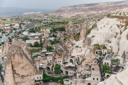 aerial view of majestic rock formations and old houses in cappadocia, turkey