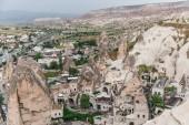 """Постер, картина, фотообои """"Аэрофотоснимок величественных скал и старые дома в Каппадокии, Турция"""""""