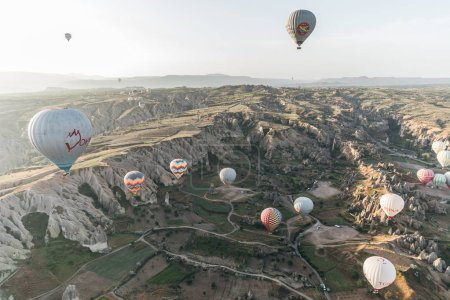 Photo for CAPPADOCIA, TURKEY - 09 MAY, 2018: beautiful hot air balloons flying above famous goreme national park, cappadocia, turkey - Royalty Free Image