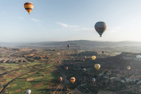 Photo for CAPPADOCIA, TURKEY - 09 MAY, 2018: colorful hot air balloons flying above majestic landscape in cappadocia, turkey - Royalty Free Image