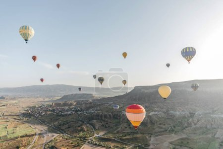 Photo for CAPPADOCIA, TURKEY - 09 MAY, 2018: beautiful colorful hot air balloons flying above cappadocia, turkey - Royalty Free Image
