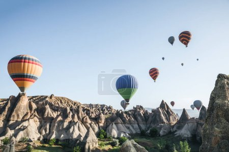 Photo for CAPPADOCIA, TURKEY - 09 MAY, 2018: colorful hot air balloons flying in sky above beautiful goreme national park, cappadocia, turkey - Royalty Free Image
