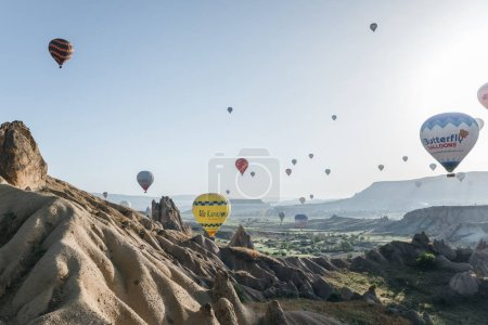 CAPPADOCIA, TURKEY - 09 MAY, 2018: colorful hot air balloons flying above goreme national park, cappadocia, turkey