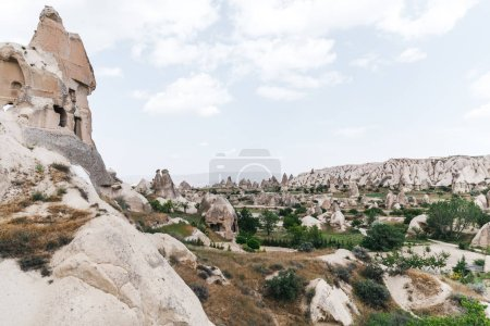 majestic view of famous rock formations and caves in cappadocia, turkey