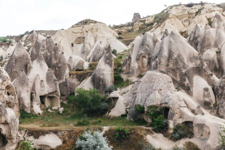 beautiful landscape with famous caves and rock formations in goreme national park, cappadocia, turkey