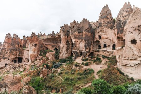 Photo for Majestic view of scenic caves in limestone at famous cappadocia, turkey - Royalty Free Image