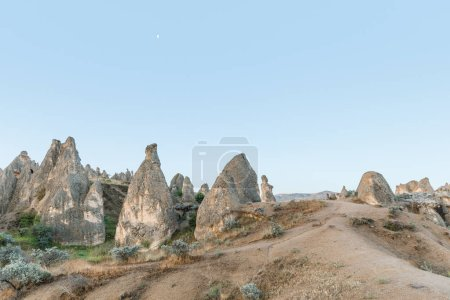 Photo for Beautiful scenic landscape with bizarre rock formations in cappadocia, turkey - Royalty Free Image