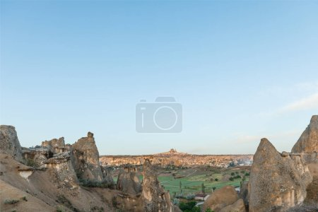 beautiful landscape with scenic rock formations and blue sky in cappadocia, turkey