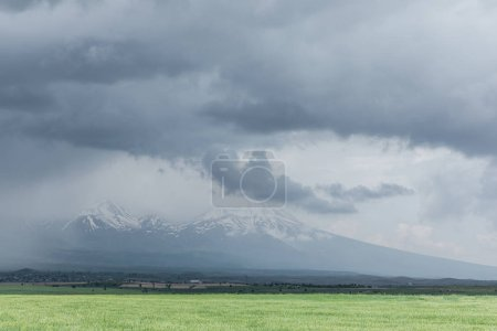 majestic landscape with snow-covered mountains at cloudy day, cappadocia, turkey