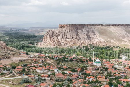 Photo for Majestic landscape with bizarre rock formations and buildings in cappadocia, turkey - Royalty Free Image