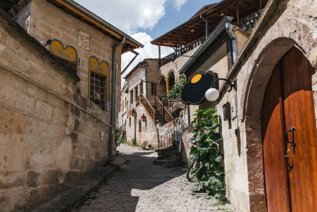 Photo for Cozy narrow street with traditional old buildings in cappadocia, turkey - Royalty Free Image
