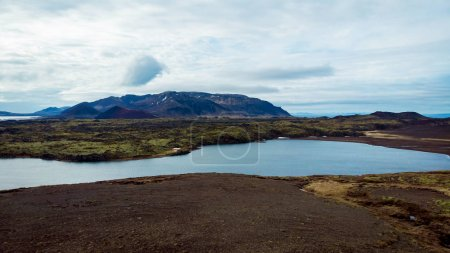 Photo for Aerial view of beautiful bay with mountains and cloudy sky on background, snaefellsnes, iceland - Royalty Free Image