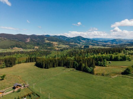 aerial view of houses, forest and mountains in arezzo province, Italy
