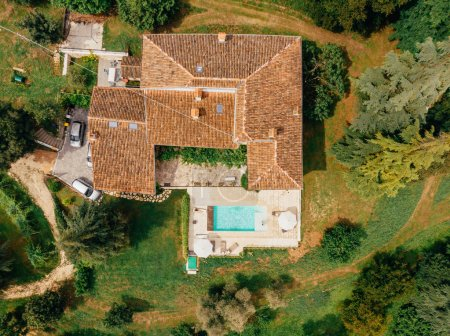 top view of couple resting at swimming pool near villa in Italy