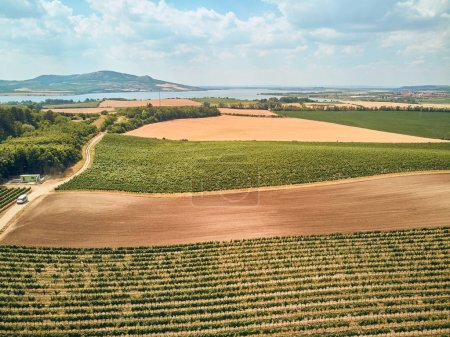 Photo for Aerial view of agricultural fields, river and mountains, Czech Republic - Royalty Free Image