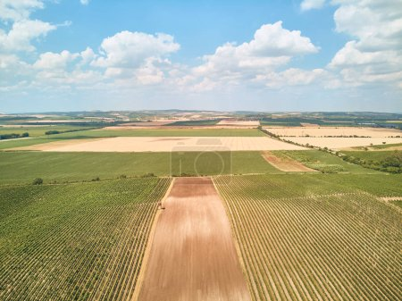 Aerial view of landscape with fields and blue sky with clouds, Czech Republic