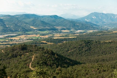 aerial view of beautiful mountains covered with green vegetation in provence, france