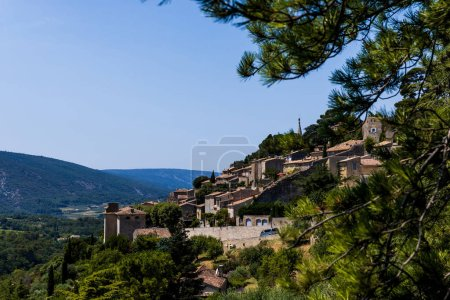 Photo for Beautiful green trees, traditional houses and scenic mountains in provence, france - Royalty Free Image