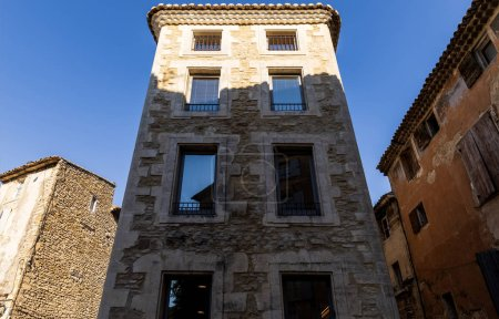 low angle view of tall historical building with large windows at sunny day, provence, france