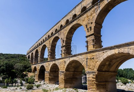 Photo for Pont du Gard (bridge across Gard) ancient Roman aqueduct across Gardon River in  Provence, France - Royalty Free Image