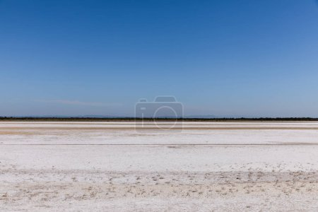 Photo for Beautiful natural background with sandy ground and distant mountains against blue sky, provence, france - Royalty Free Image