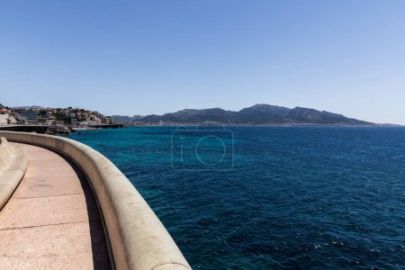 Photo for Empty embankment and distant mountains at sea in provence, france - Royalty Free Image