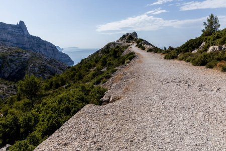 Photo for Rural road on mountain range, rocky mountains and scenic sea view in Calanques de Marseille (Massif des Calanques), provence, france - Royalty Free Image