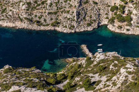 Photo for Aerial view of boats in harbour and beautiful rocky mountains in Calanques de Marseille (Massif des Calanques), provence, france - Royalty Free Image
