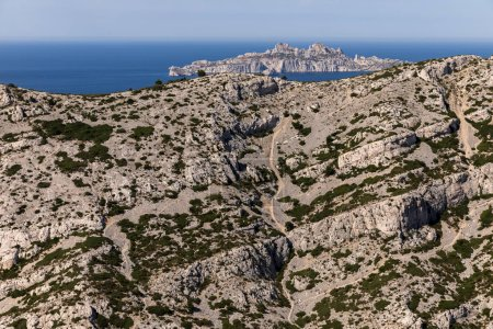 aerial view of beautiful rocky mountains, winding road and scenic sea shore in Calanques de Marseille (Massif des Calanques), provence, france