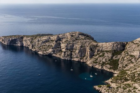 aerial view of scenic cliffs and yachts in harbour in Calanques de Marseille (Massif des Calanques), provence, france