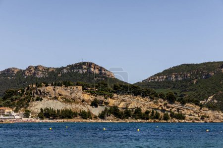 beautiful rocky mountains with green vegetation and tranquil seascape in provence, france