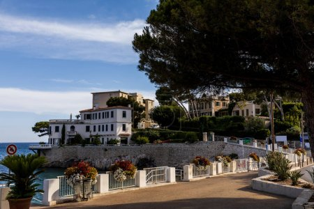 Photo for Empty embankment and beautiful houses at sea coast in provence, france - Royalty Free Image