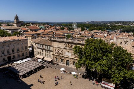 Photo for AVIGNON, FRANCE - JUNE 18, 2018: aerial view of pedestrians on streets and square, beautiful old architecture and scenic cityscape of historical european city Avignon - Royalty Free Image