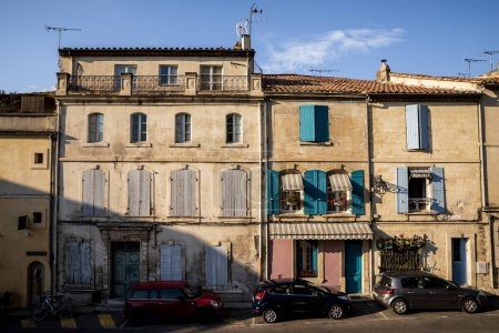 PROVENCE, FRANCE - JUNE 18, 2018: cars on street and beautiful old buildings in provence, france