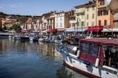 AVIGNON, FRANCE - JUNE 18, 2018: boats in port and people walking on embankment, Avignon, france
