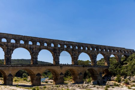 PROVENCE, FRANCE - JUNE 18, 2018: Pont du Gard (bridge across Gard) ancient Roman aqueduct across Gardon River in  Provence, France