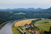 aerial view of beautiful elbe river, fields and houses in Rathen, Germany