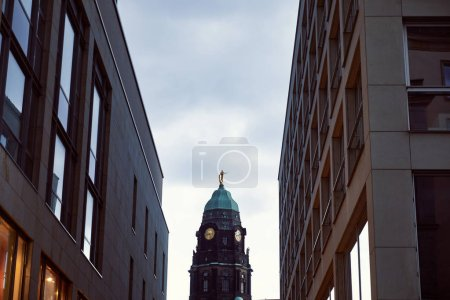 Photo for Low angle view of tower with clock between modern buildings in Dresden, Germany - Royalty Free Image